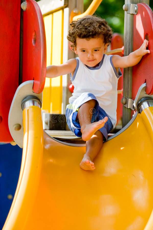 Playing On Slide royalty free stock image