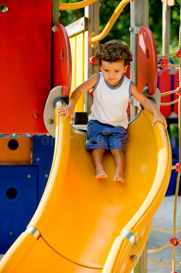 Playing On Slide royalty free stock images