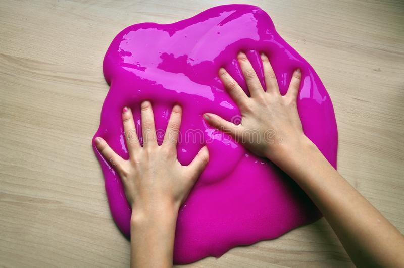 Playing with slime. A child playing with slime mucus with his hands in creative game royalty free stock photo