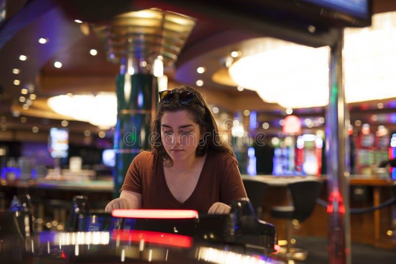 Playing slot machines stock photo