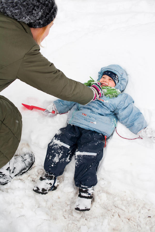 Download Playing in snow stock image. Image of mother, laughing - 23331261