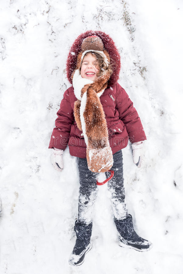 Playing in the snow. Little child playing in the snow royalty free stock photography