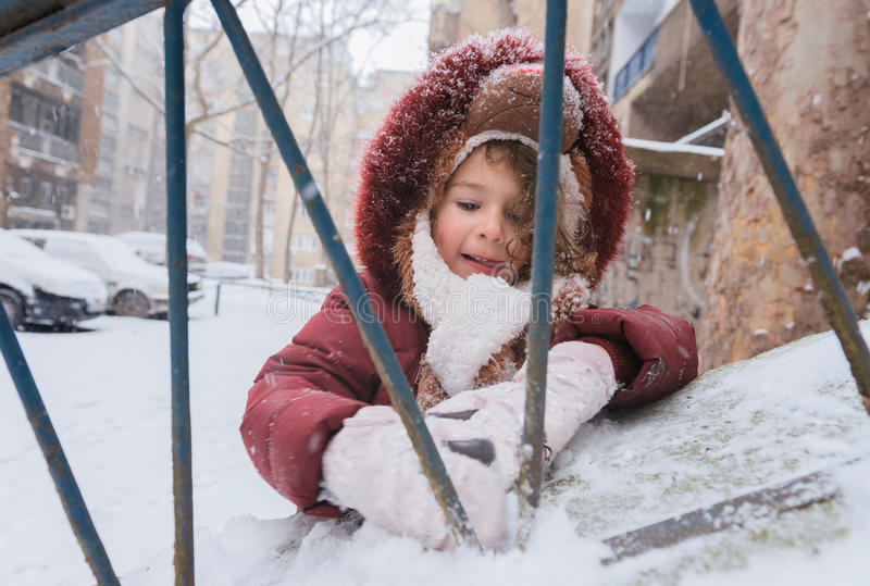 Playing with snow. Little child playing with the snow,selective focus stock photo