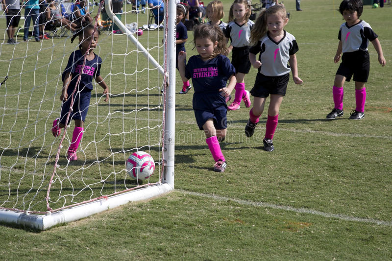 Little girls playing soccer stock photos