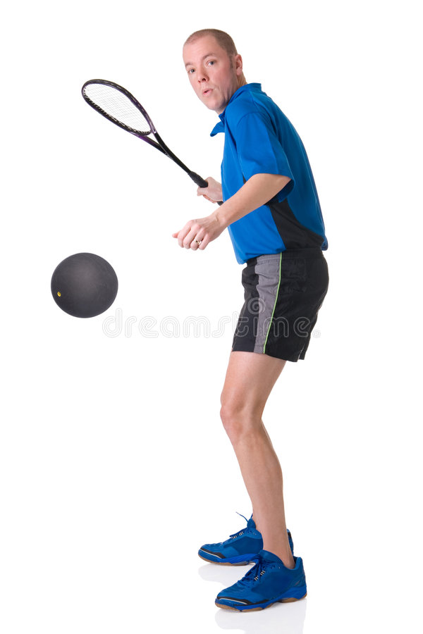 Playing squash. Full isolated picture of a caucasian man playing squash royalty free stock image