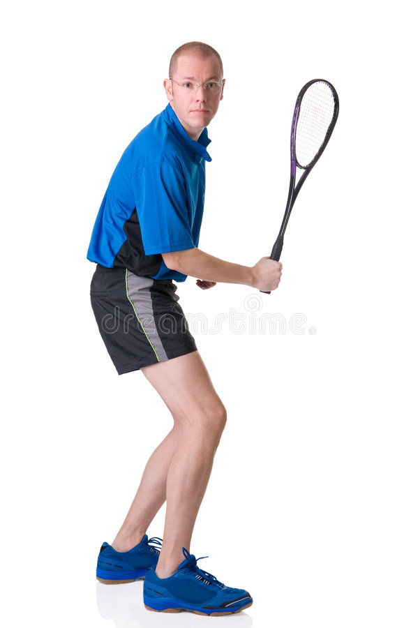 Playing squash. Full isolated picture of a caucasian man playing squash stock photo
