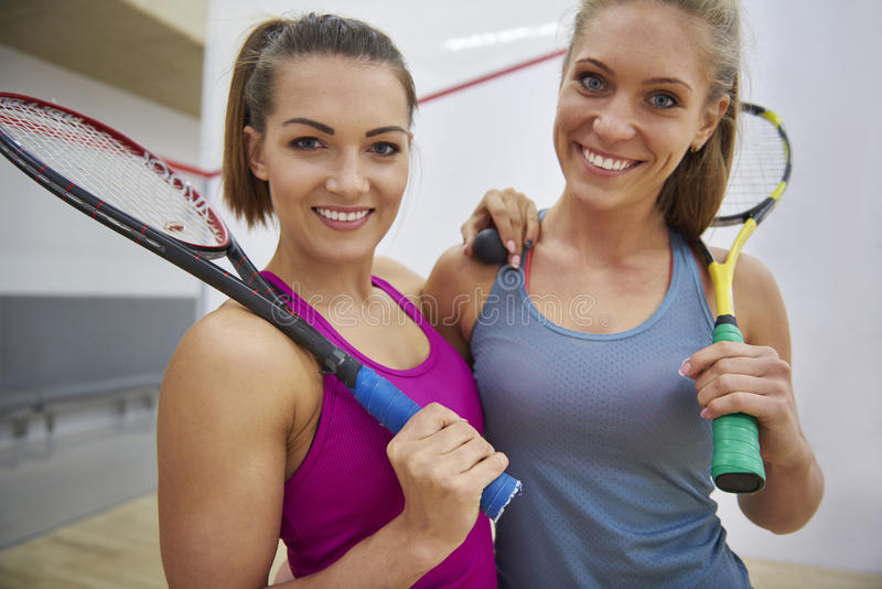 Playing squash with friends stock photos