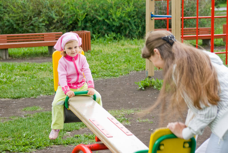 Download Playing on a swing stock photo. Image of mother, small - 15028140
