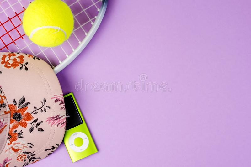 Playing tennis, sport practising, leisure activities. Closeup of sport and leisure tools while doing sport and taking a breath while listening music, top view royalty free stock photography
