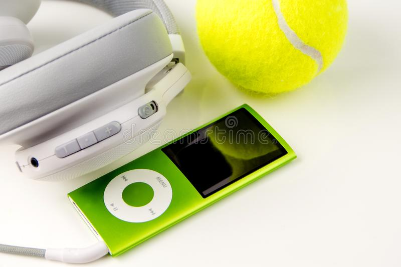 Playing tennis, sport practising, leisure activities. Closeup of sport and leisure tools while doing sport and taking a breath while listening music, top view stock photography