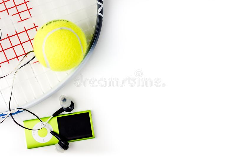 Playing tennis, sport practising, leisure activities. Closeup of sport and leisure tools while doing sport and taking a breath while listening music, top view stock photos