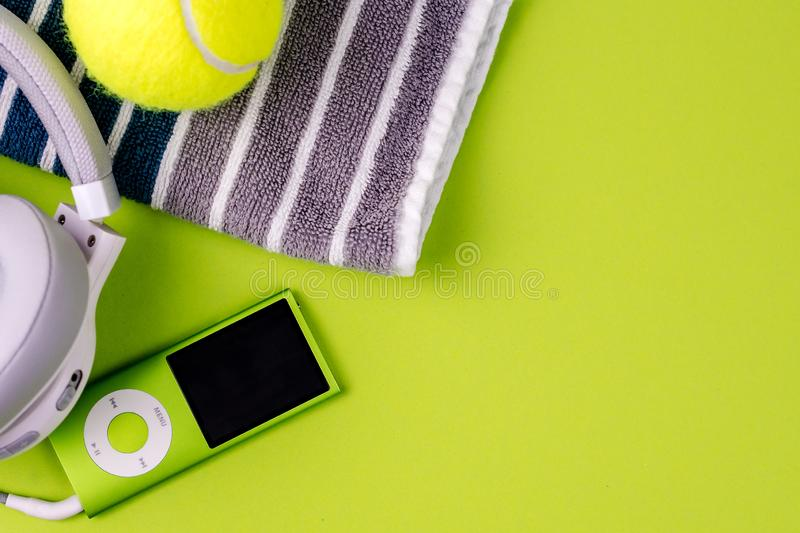 Playing tennis, sport practising, leisure activities. Closeup of sport and leisure tools while doing sport and taking a breath while listening music, top view royalty free stock image