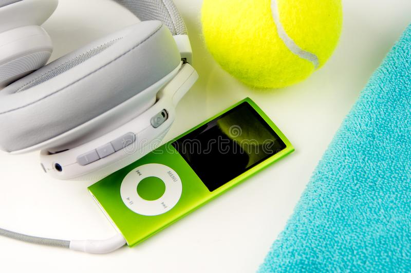 Playing tennis, sport practising, leisure activities. Closeup of sport and leisure tools while doing sport and taking a breath while listening music, top view royalty free stock photos