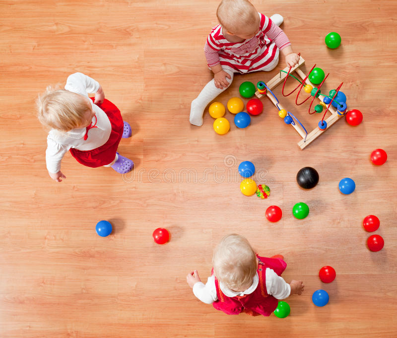 Playing toddlers stock photography