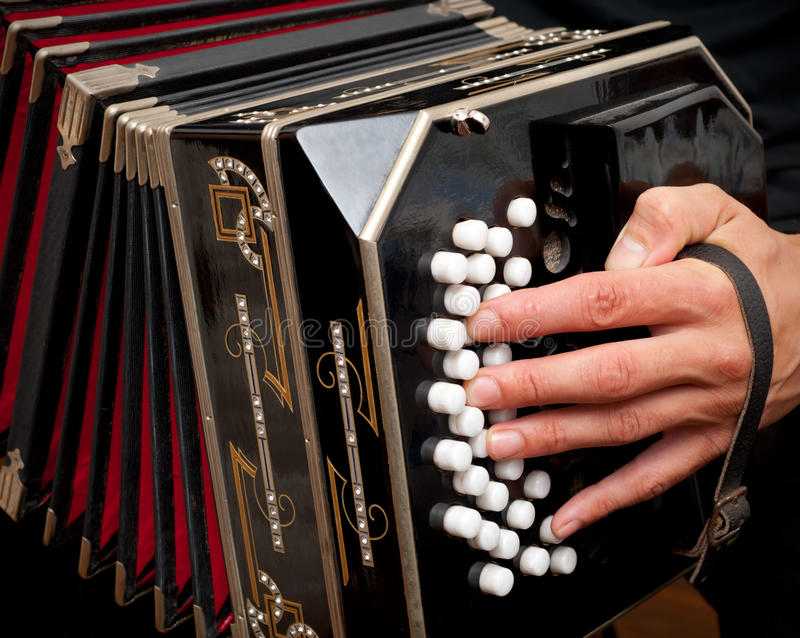 Playing traditional bandoneon. stock images