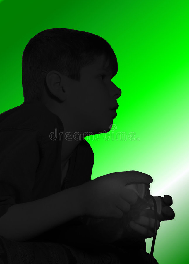 Playing Video Game. This is a silhouette of a boy playing a video game. Please note that the larger the print, the more you can see some actual detail of the boy stock images