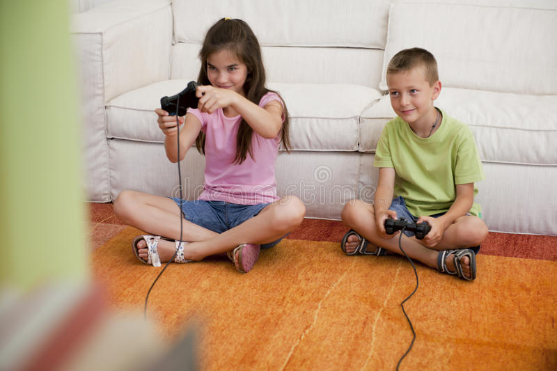 Download Playing video games stock image. Image of holding, innocence - 25828903