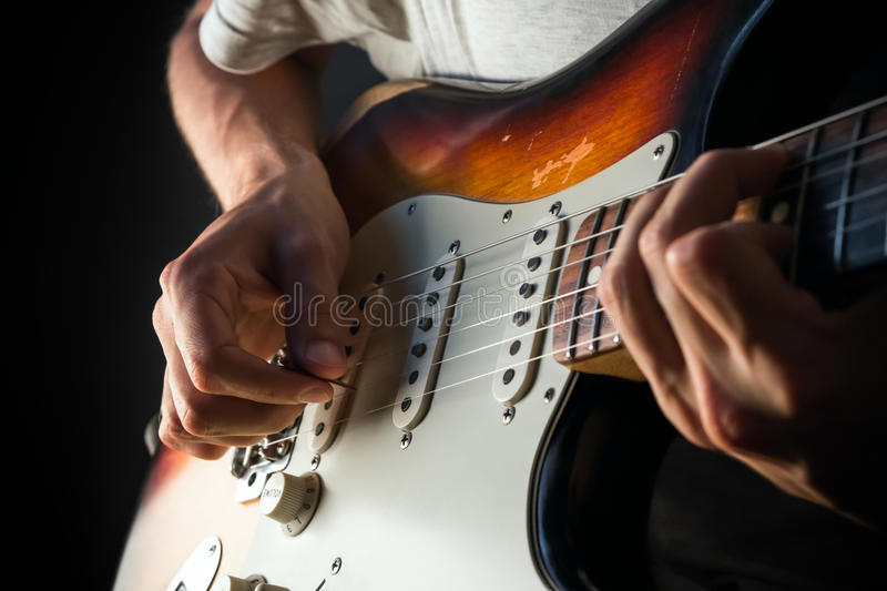 Playing a vintage electric guitar stock image