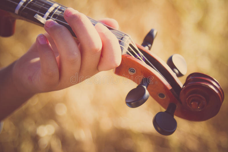 Playing the Viola. Learning to play the Viola stock image