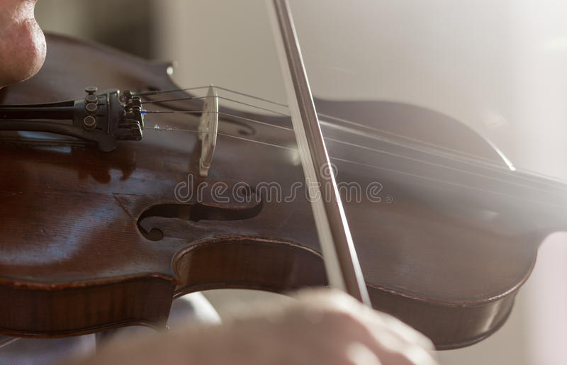 Playing Violin. Male hand playing violin close up royalty free stock photos