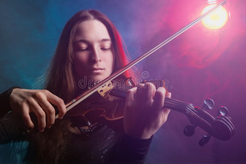 Playing the violin stock images