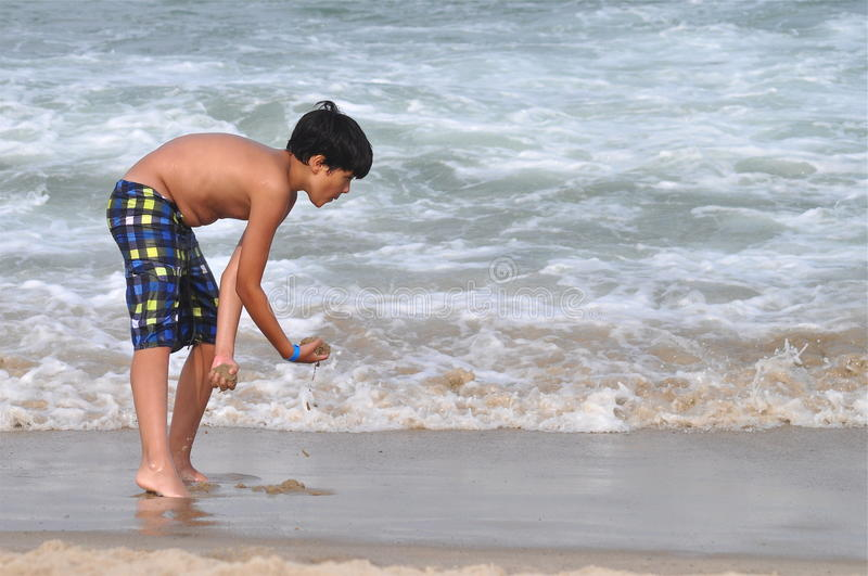 Download Playing With Wet Sand Royalty Free Stock Images - Image: 28390699