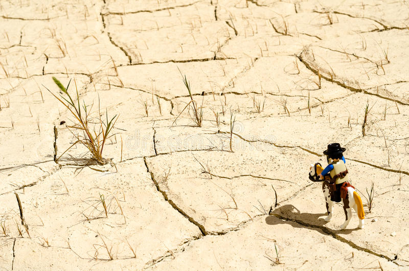Playmobil sheriff and horse standing in desert royalty free stock photo