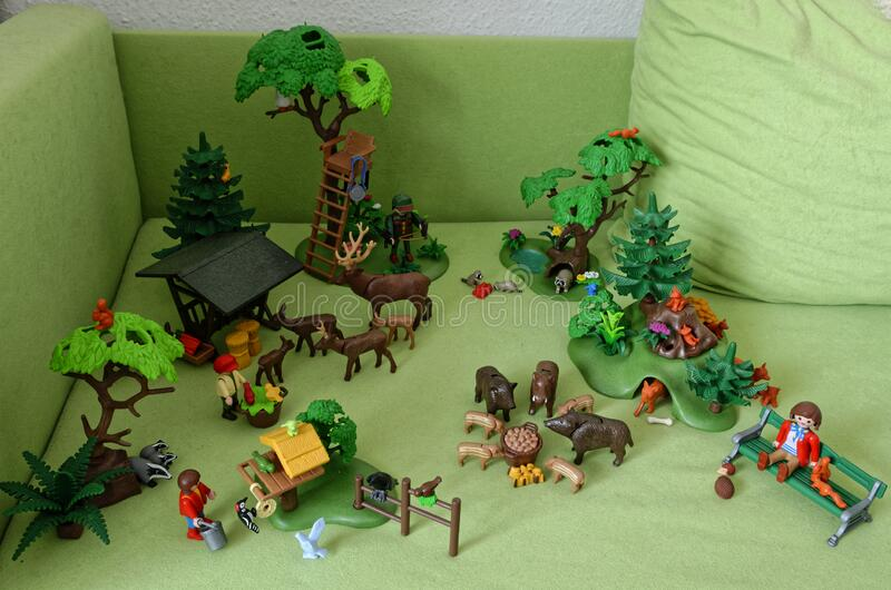 Playmobil toys of woodland animals arranged on green sofa royalty free stock photos