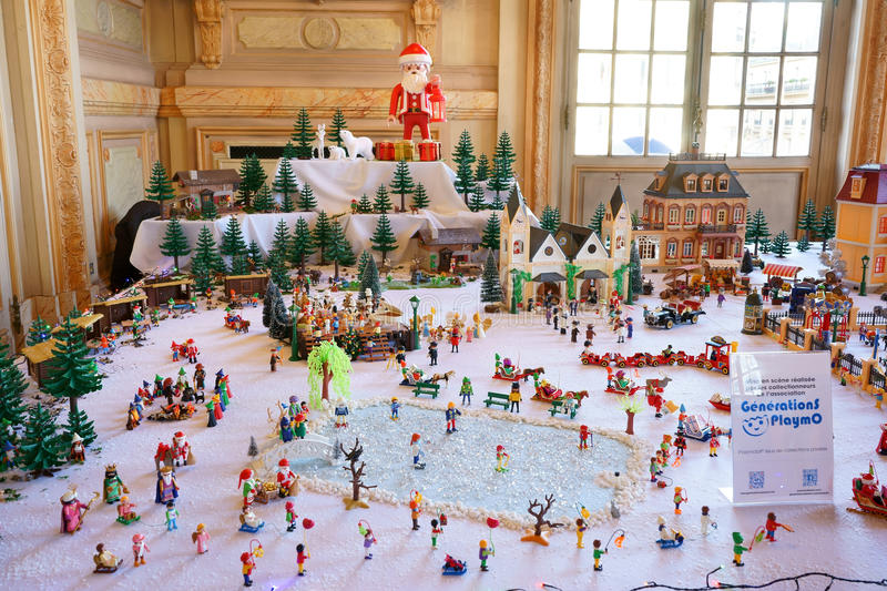 Playmobil Winter Landscape. Playmobil winter scene with a church, houses, pine trees, Swiss chalets, a frozen lake, etc. belonging to collectors. Exposed at stock images