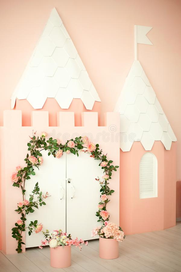 Playroom with pink castle decoration for children. Children`s room for a little princess. Decorations for a child`s party. Little stock image