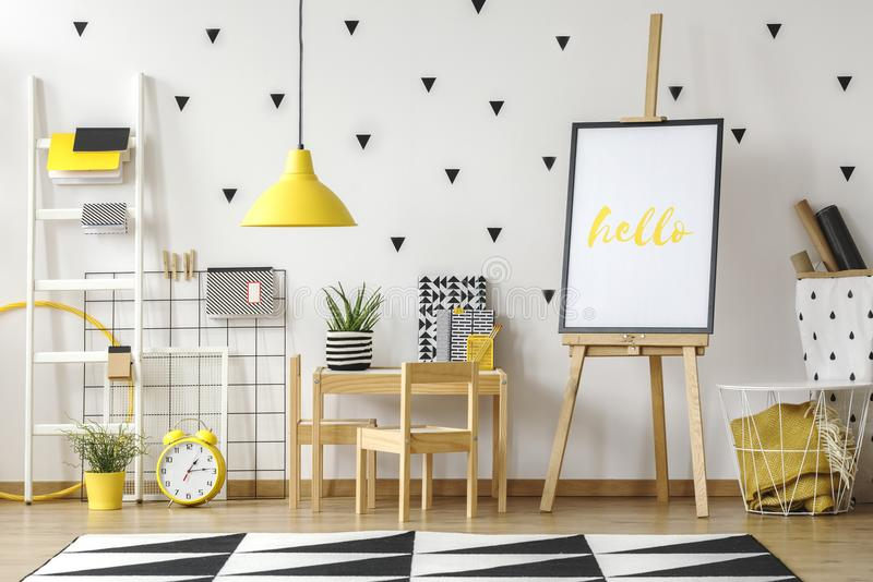 Playroom and study corner for a child in a fun room interior wit stock images