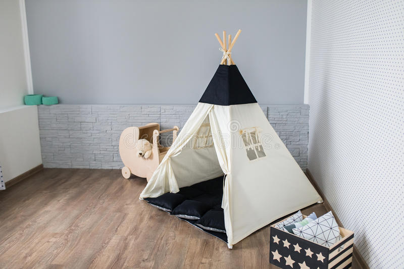 Playroom with Teepee. Light Playroom for kids with Teepee tent royalty free stock photos