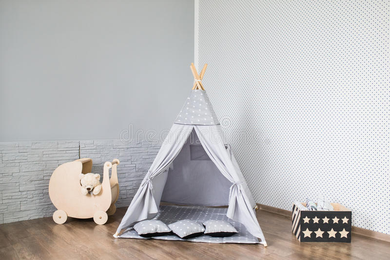 Playroom with Teepee. Light Playroom for kids with Teepee tent stock image