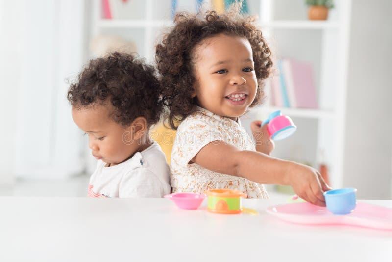 At playroom. Two mixed-race kids having fun at playroom royalty free stock image