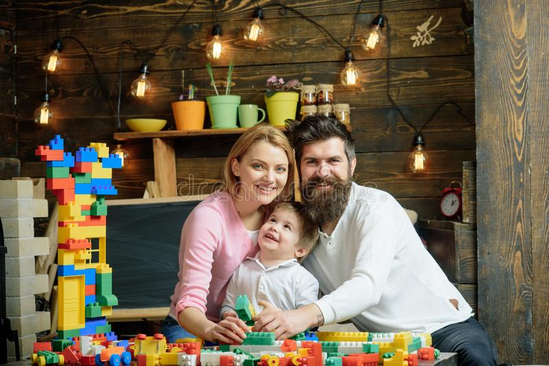 Playschool concept. Playschool kid play with mother and father. Happy family in playschool. Playschool education and stock image