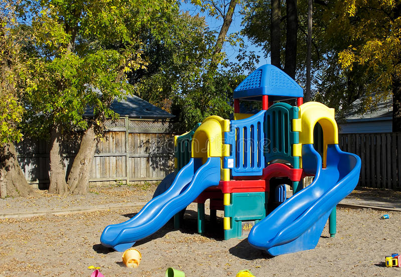 Playset at Daycare Center. Blue slides in outdoor recreation area of daycare center royalty free stock photo