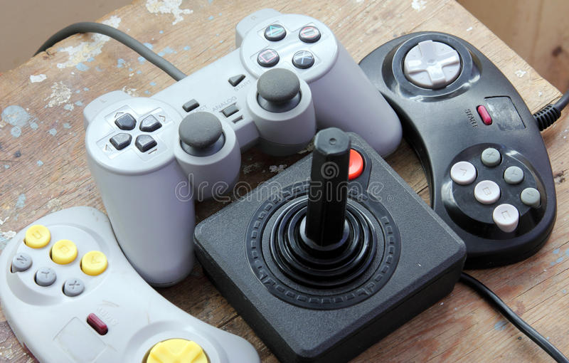 Playstation joystick with vintage joystick. Play station joystick with vintage joystick for controller and playing video game on rustic wooden background stock photo