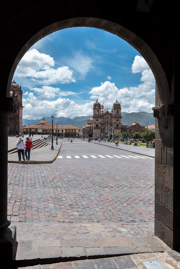 Plaza de Armas in Cusco, Peru. As seen from behind an arch stock image