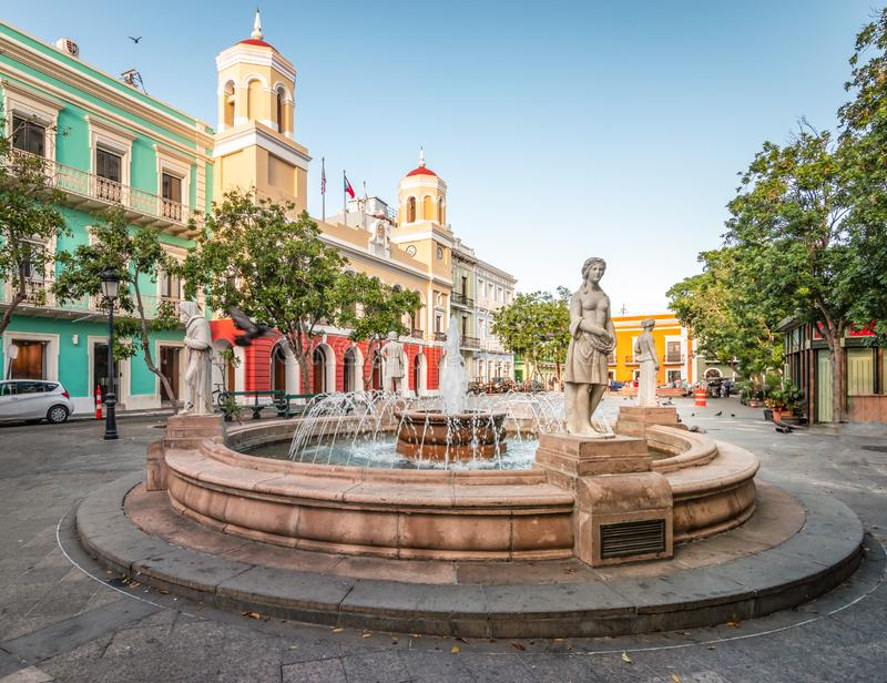 Fountain in the city centre of Old San Juan, Puerto Rico. Plaza de Armas, town square with water fountain in the city centre of Old San Juan, Puerto Rico. City stock image