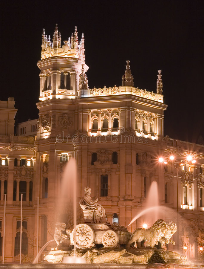Plaza de Cibeles, Madrid at night. Plaza de Cibeles in Madrid, Spain at night. With Cibeles Fountain and the Royal Mail office in the background (Palacio de stock image