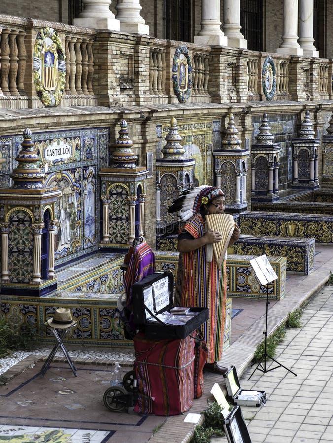 Plaza de España, Seville, Spain - Native American playing flute royalty free stock photo