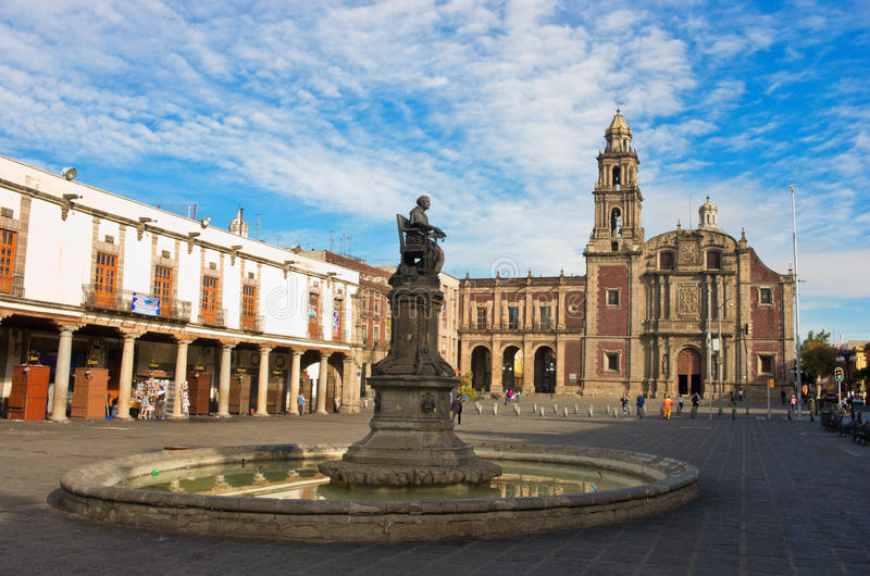 Plaza de Santo Domingo in Mexico city. Mexico city, December 04, 2016: Church of Santo Domingo and statue of the Corregidora Josefa Ortiz de Dominguez at Plaza stock image