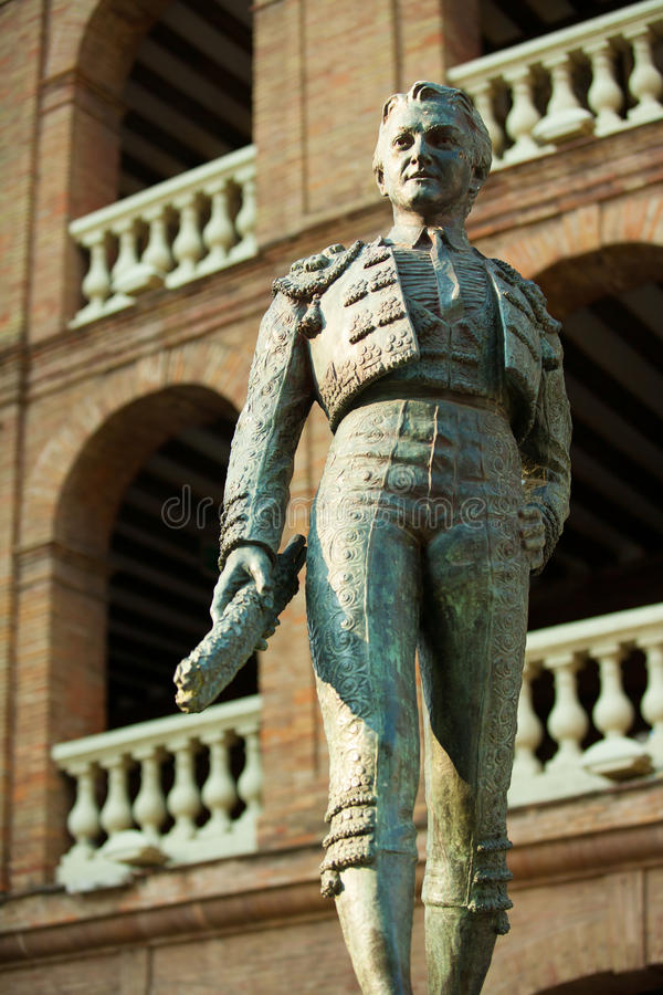 Plaza de toros de Valencia bullring with toreador statue stock images
