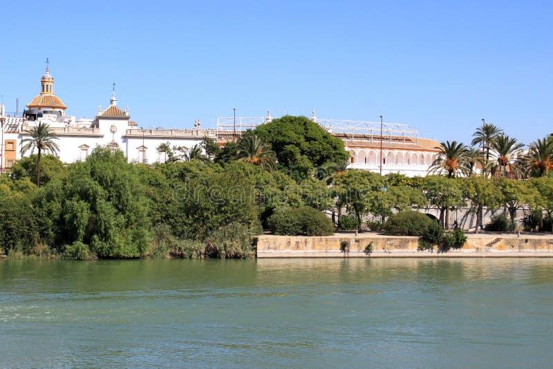 Plaza de Toros and the Guadalquivir River, Seville. View of Seville over the Guadalquivir River, with the 18th century Plaza de Toros de la Real Maestranza, one stock photography