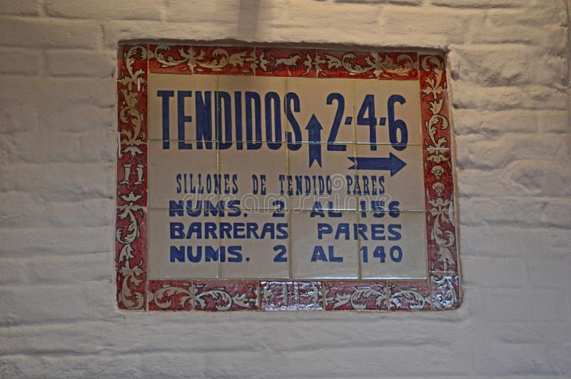 Seville - interior - tiled detail sign - The Plaza de toros de la Real Maestranza de Caballería de Sevilla royalty free stock photos