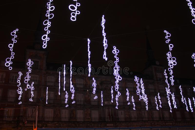 Plaza Mayor in Madrid with Christmas Decoration. Plaza mayor main square of madrid decorated with christmas lights and tinsel royalty free stock image