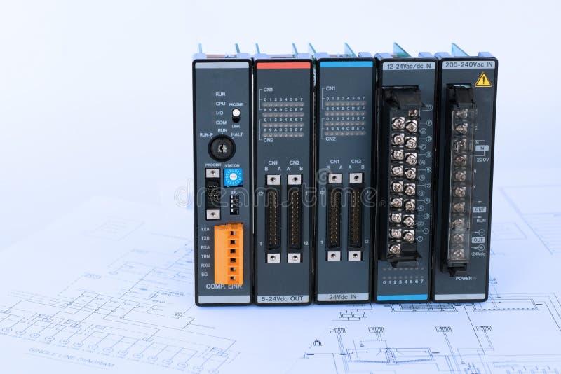 PLC and process diagram in blue tone. Industrial PLC modules place on process control diagram blueprint stock photos