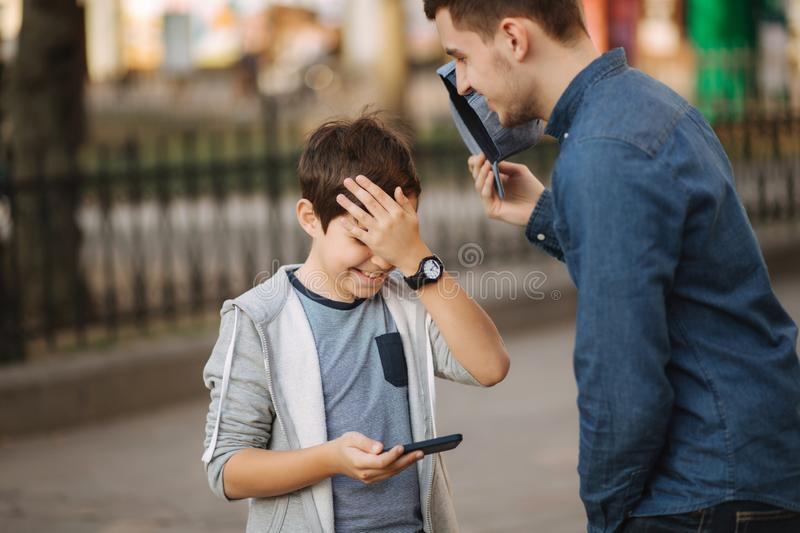 Plder brother explain to younger how to use phone royalty free stock image