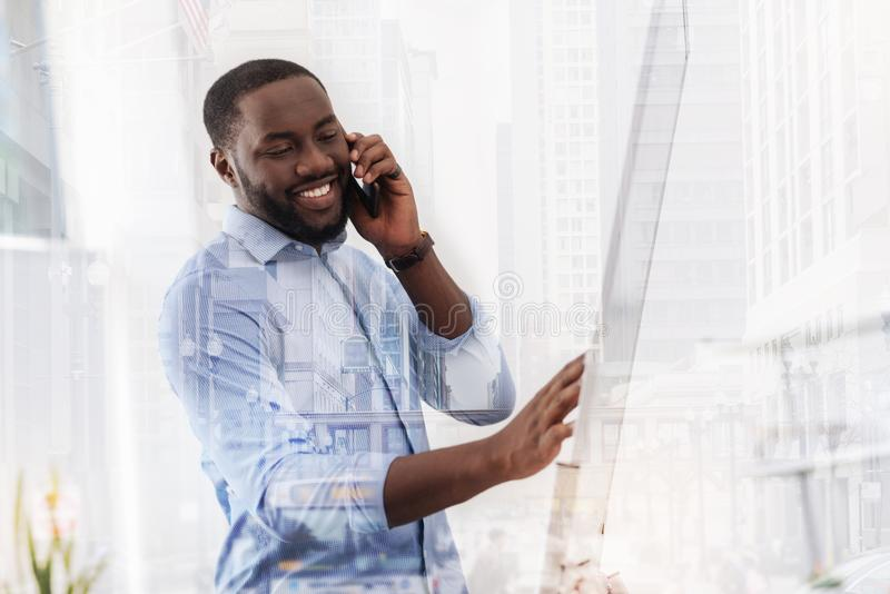 Pleasant African American having a talk on the mobile phone stock photos