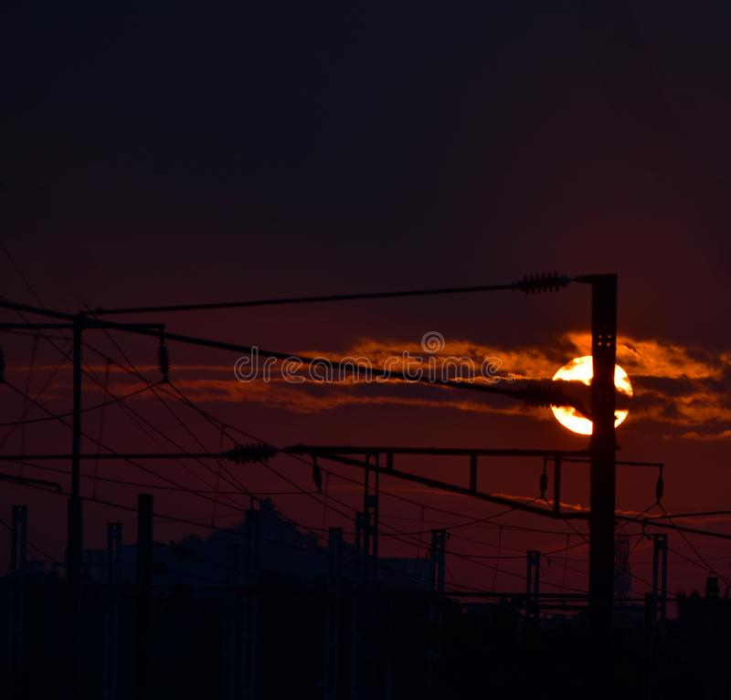Sunset photograph captured from a railway station. The pleasant and beautiful sunset scene in the evening captured from a railway station in India royalty free stock photos
